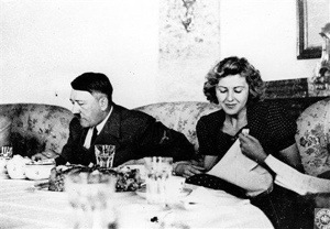 Adolf Hitler and mistress Eva Braun enjoying a meal.